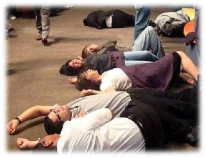 """These folks either got tired of standing up or they are """"slain in the spirit"""""""