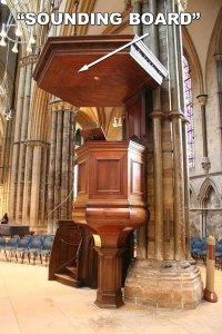 "You can see the use of a ""sounding board"" over the pulpit in this photo."